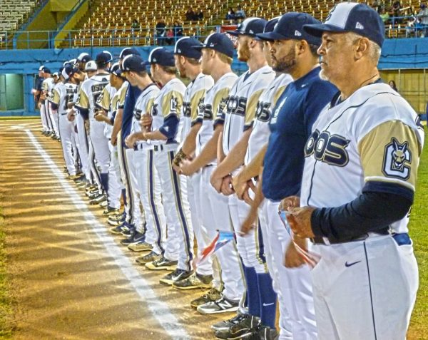The Roos lining the 3rd base side of the diamond while the pregame festivities took place.  (Photo by Fred Saburro)