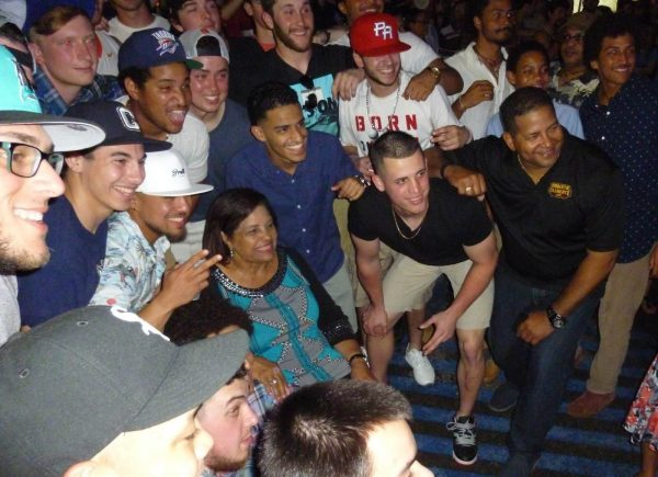 """The SUNY Canton Kangaroos Baseball team with Mrs. Clemente and family shortly after singing """"Happy Birthday"""" to her.  Included in this photo are Luis Caballero, Gerald Abillar, Christopher Lee, Vinny Bondinello, Cristian Cruz, Wilson Matos, myself, Axel Riviere, Erdous Lebron, Derrick Machado, Travis Bigelow, Greg Dobies, Travis Schindler, and Dan Coant as well as Luis and Vera Clemente. (Photo by Fred Saburro)"""